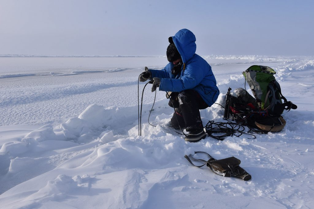 Jana Winderen conducting field recordings 15 meters under the sea ice with hydrophones by the North Pole. Photo: MAMONT Foundation.